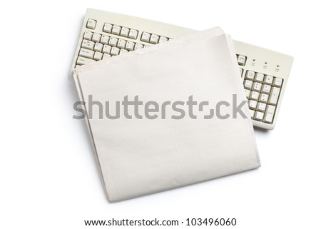 Computer Keyboard and Newspaper with white background - stock photo