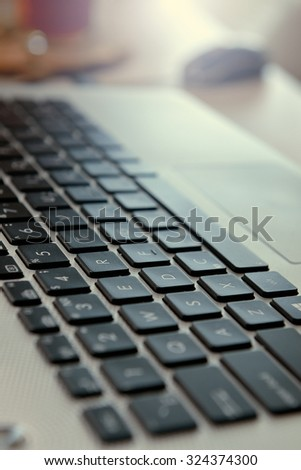 Computer keyboard background. Shallow DOF. the white balance shifted