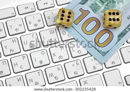 Computer Keyboard Close-up,  Gaming Dices And USA Dollar Cash.  On Line Gambling Game Concept - stock photo