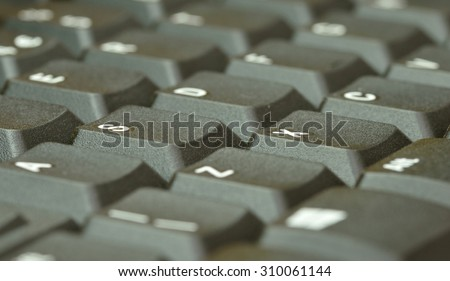 Computer keyboard. Close up of mostly blurred keys on an acute angle. - stock photo