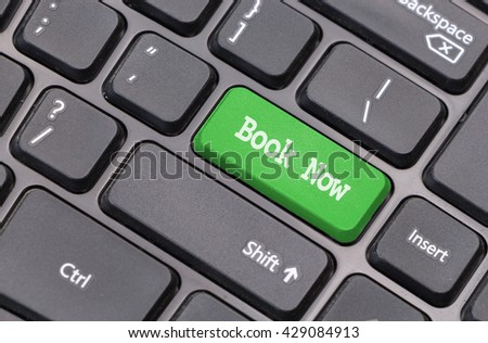 "Computer keyboard closeup with ""Book Now"" text on green enter key"