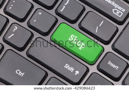 "Computer keyboard closeup with ""Shop"" text on green enter key"