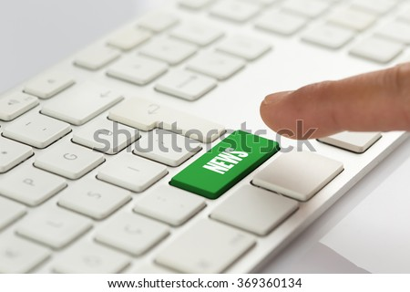 Computer Keyboard Concept: Hand pushing green NEWS keyboard button - stock photo