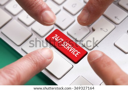 Computer Keyboard Concept: Many fingers pushing red 24/7 SERVICE keyboard button - stock photo