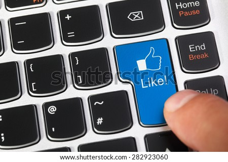 Computer keyboard enter key with like thumbs up icon concept for social media, social networking and approval - stock photo