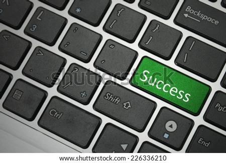 Computer keyboard - green key Success  - stock photo