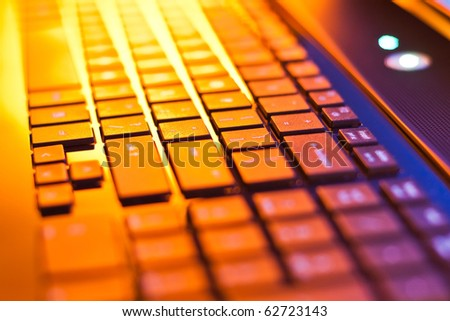 computer keyboard in mixed light