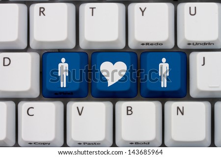 Computer keyboard keys with symbols of man and man and a heart, Internet Dating - stock photo
