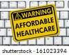 Computer keyboard keys with warning sign with words Affordable Healthcare, Warning of Affordable Healthcare - stock photo