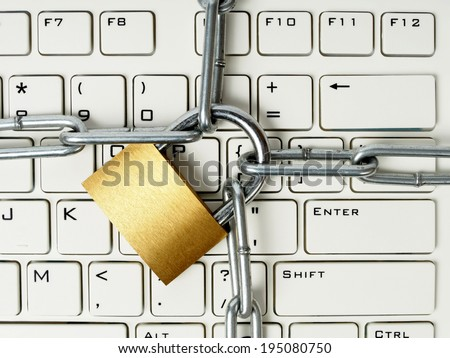 Computer keyboard locked with padlock and chain