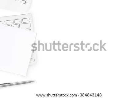 Computer keyboard, mouse, notebook and pen are on isolated white background, top view with copy space. - stock photo