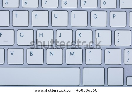 Computer keyboard on blue background. High resolution.
