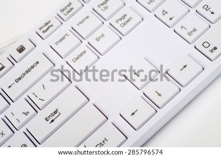 Computer keyboard on isolated white background, close up view - stock photo