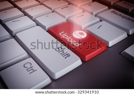 Computer keyboard with an upload red key - stock photo