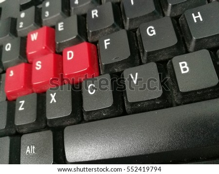 computer keyboard with black and red keys