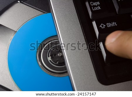 computer keyboard with blue disc, download program concept . - stock photo