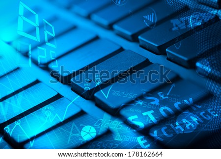 Computer keyboard with glowing business management icons and diagram