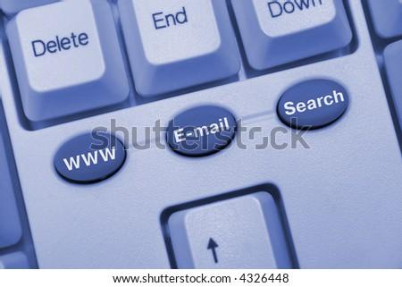 Computer keyboard with internet keys, blue toning - stock photo