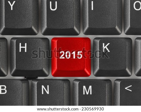 Computer keyboard with 2015 key - holiday concept - stock photo