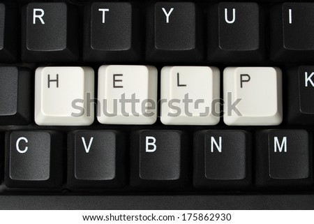 Computer keyboard with keys forming help word.