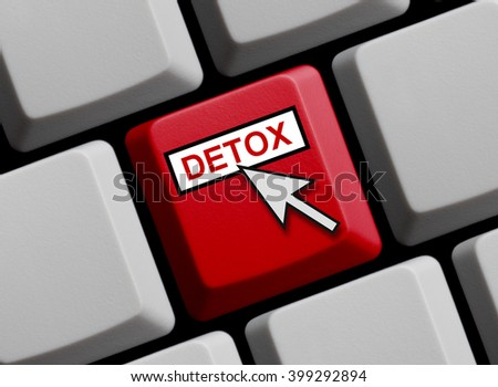 Computer Keyboard with mouse arrow is showing Detox