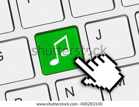 Computer keyboard with music key - technology background - stock photo