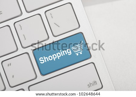 Computer keyboard with on-line shopping symbol on it - stock photo