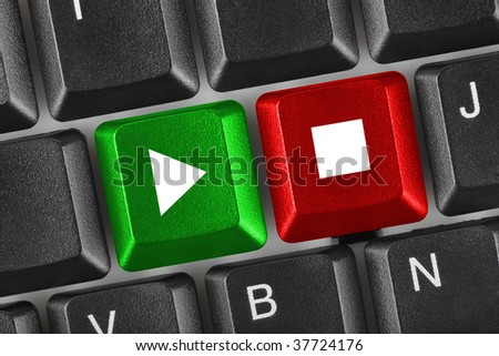 Computer keyboard with Play and Stop keys - multimedia concept - stock photo