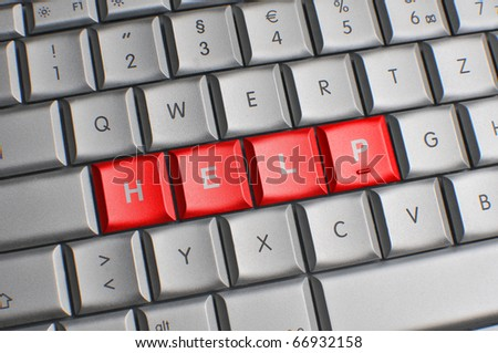 Computer keyboard with red help keys - stock photo