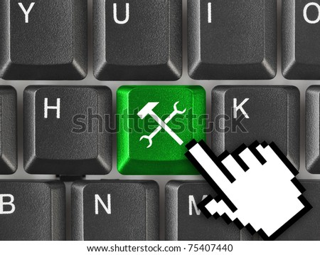 Computer keyboard with tools key - technology background - stock photo