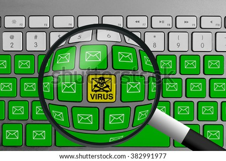 Computer keyboard with yellow email virus button surrounded with green email buttons and magnifying glass
