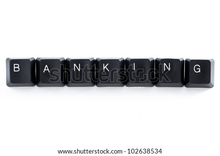 computer keys spelling the word banking on white background - stock photo