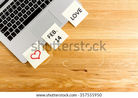 computer, laptop keyboard with notice that february 14 is Valentine's day. Reminder with sticky papers with love, don't forget and red heart symbol - stock photo