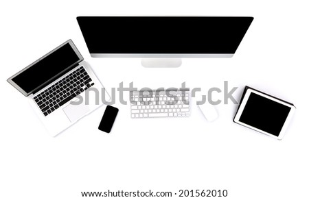 Computer ,laptop , tablet , smart phone on table - stock photo