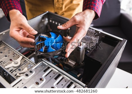 Computer literacy repair men hands, man examines laptop clean thermal paste, dust pollution, fan