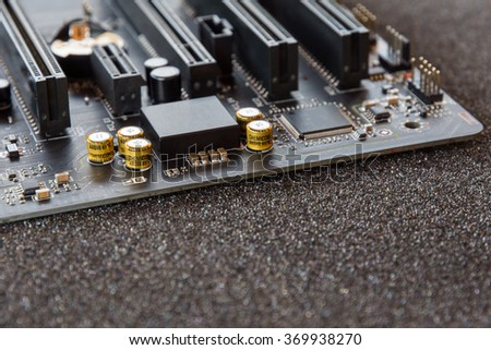 computer mainboard. Electronic printed circuit board chemicon - stock photo