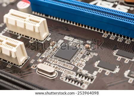 Computer Micro Chipset Circuit Board And PCI Slots - stock photo