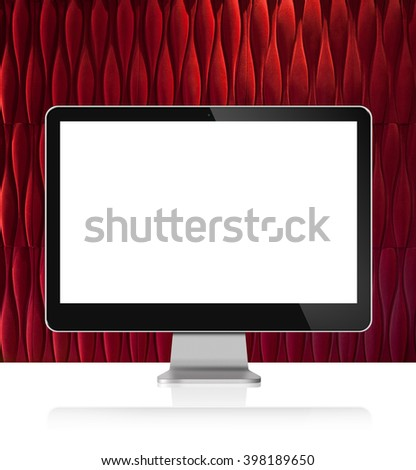 Computer Monitor on white table with red wall background - stock photo
