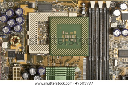 Computer motherboard, CPU socket view with CPU (pins up) - stock photo