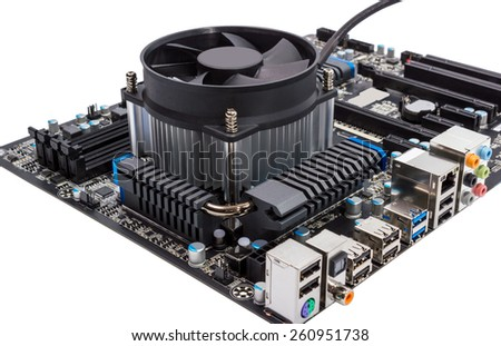 Computer motherboard isolated on white background with CPU cooler - stock photo