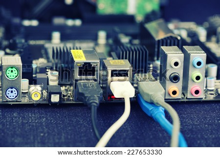 Computer motherboard, wires connected via USB. Got conection. - stock photo