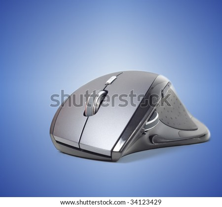 Computer mouse against a blue background.