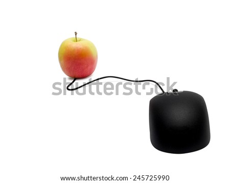 Computer mouse and apple. Online learning concept