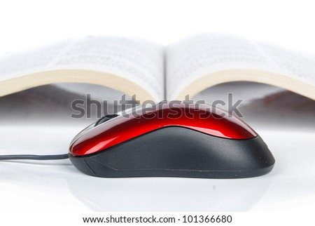 Computer mouse and book - stock photo