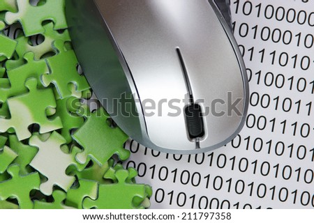 computer mouse and  puzzles on a binary code - stock photo