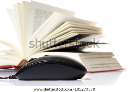 Computer mouse and stack of books isolated on white background.