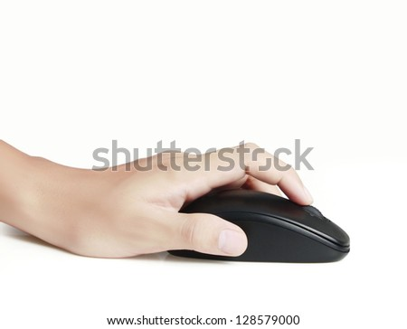 computer mouse in a hand - stock photo