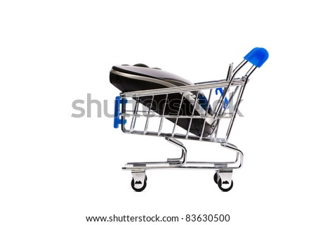 Computer mouse in shopping cart. Isolated on white.