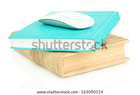 Computer mouse on books isolated on white - stock photo