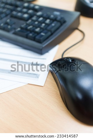 computer mouse on desk and sheet